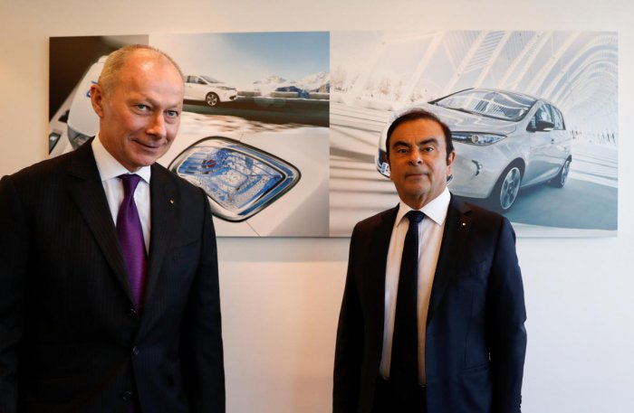 Carlos Ghosn (L), Chairman and Chief Executive Officer of Renault, and Thierry Bollore, Renault Chief Operating Officer, attend the French carmaker Renault's 2017 annual results presentation at their headquarters in Boulogne-Billancourt, near Paris, Franc