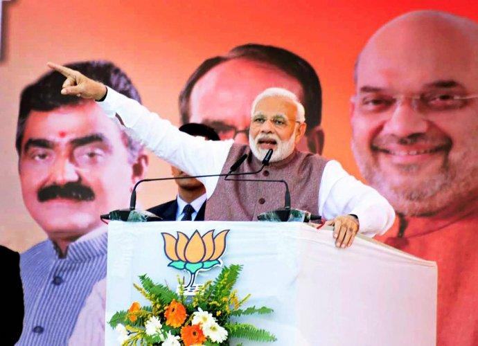 Prime Minister Narendra Modi addresses a public meeting. PTI