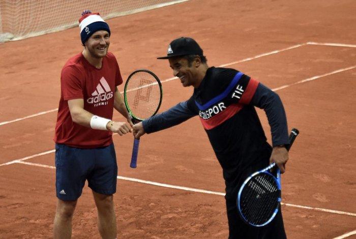 France's Lucas Pouille (left) with coach Yannick Noah at a training sessionahead of the Davis Cup final against Croatia. AFP