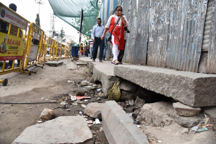 A pedestrian path in bad condition at the entrance of Mantri Square Sampige Metro Station. DH Photo/ B H Shivakumar