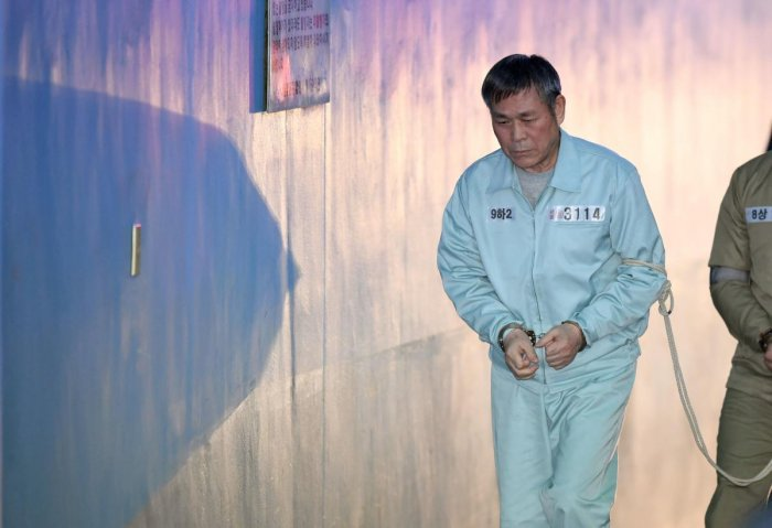 South Korean pastor Lee Jaerock arrives at the Seoul Central District Court to attend his trial in Seoul on November 22, 2018. - The South Korean cult leader was convicted on November 22 of the multiple rape of eight female followers - some of whom believ