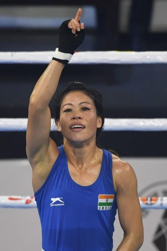 THE ONE AND ONLY: Mary Kom signals her victory in her semifinal against Kim Hyang Mi of North Korea in the women's World Boxing Championships on Thursday. AFP