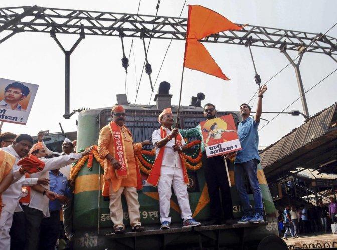 Shiv Sena activists board a train for Ayodhya to attend Vishwa Hindu Parishad Dharma Sabha on Nov 25, at Thane Railway Station. PTI Photo