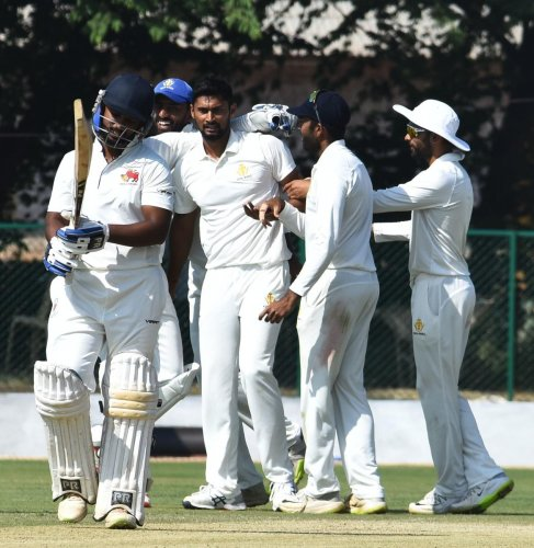 Karnataka paceman Ronit More (centre) is congratulated by team-mates after dismissing a Mumbai batsman in the Ranji Trophy game at Belagavi on Thursday. DH PHOTO/ Tajuddin Azad