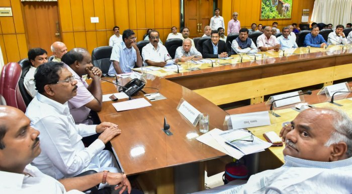 THRASHING OUT SOLUTION: Chief Minister Kumaraswamy speaks at a meeting of sugar factory owners in Bengaluru on Thursday. Deputy Chief Minister Parameshwara is also seen.