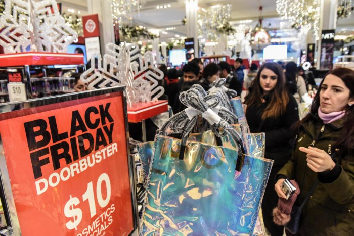 People shop during a Black Friday sales event at Macy's flagship store on 34th St. in New York City, U.S., November 22, 2018. REUTERS/Stephanie Keith