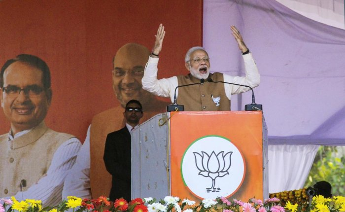 """Addressing a rally, Modi, in an apparent dig at UPA chairperson Sonia Gandhi, said 125 crore people of the country were the """"high-command"""" of his government, which was """"not remote-controlled by a madam"""". (PTI File Photo)"""