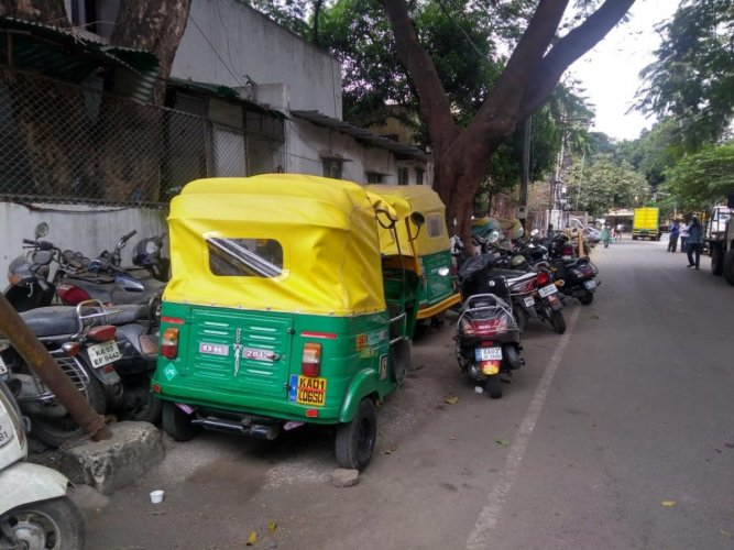 Blocked: The footpaths near the Jeevan Bima Nagar police station are jam-packed with vehicles seized by the traffic police, making it difficult for the pedestrians.