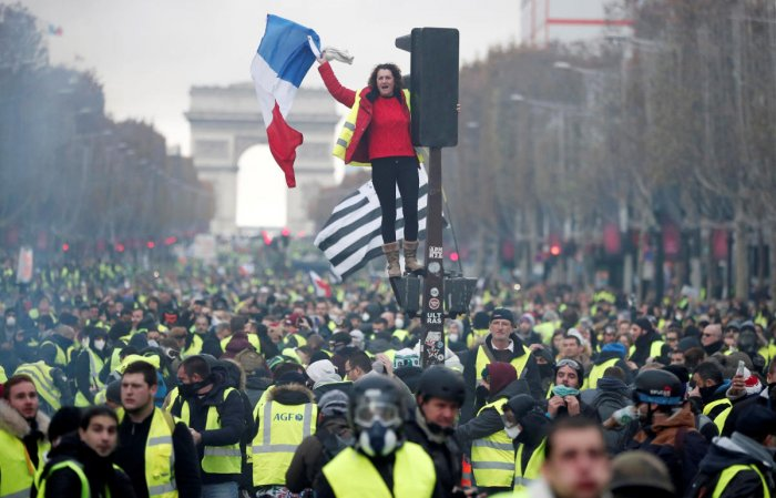 Thousands protest against higher fuel prices and tax on the Champs-Elysee in Paris, France, on November 24, 2018. Reuters
