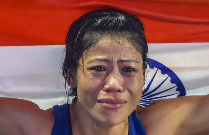 Indian boxer Mary Kom gets emotional as she celebrates after winning the final match of women's light flyweight 45-48 kg against Ukraine's Hanna Okhota at AIBA Women's World Boxing Championships, in New Delhi, Saturday, November 24, 2018. (PTI Photo)