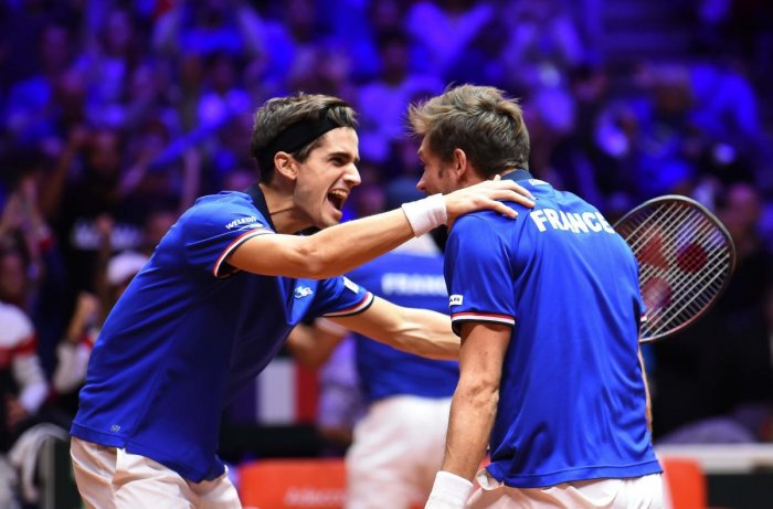 Joyous: France's Pierre-Hugues Herbert (left) and Nicolas Mahut celebrateafter beatingCroatia's Ivan Dodig and Croatia's Mate Pavic in their doubles match on Saturday. AFP