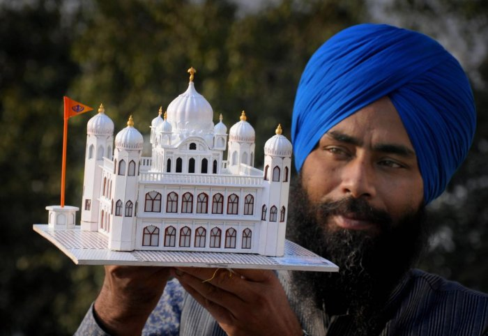 Amritsar: Paper artist Gurpreet Singh shows his creation, a paper model of Guru Nanak Dev Ji's gurudwara (Kartarpur Sahib) in Pakistan, in Amritsar, Thursday, Nov. 22, 2018. The Indian government has given permissions to build a corridor on the Indian side which would felicitate pilgrims to go across the border to pay obeisance at the sacred Sikh shrine. (PTI Photo)