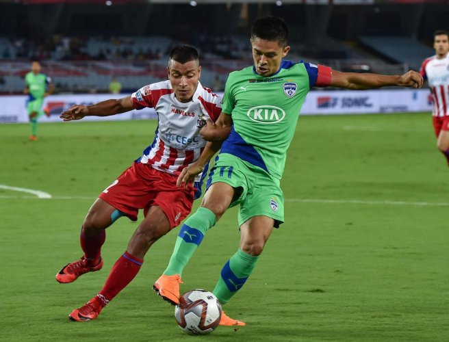 All eyes will be on Bengaluru FC captain Sunil Chhetri when he makes his 150th appearance for the club against bottom-placed Delhi Dynamos in the Indian Super League on Monday. PTI file photo