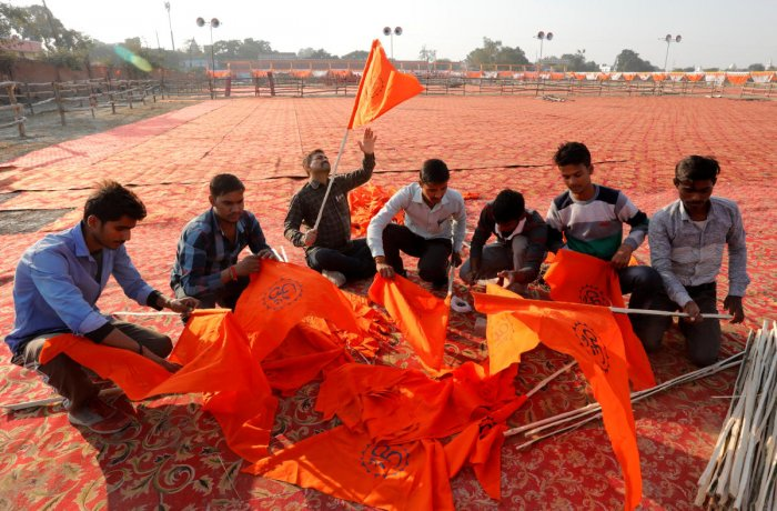 "VHP supporters prepare flags at the venue of Sunday's ""Dharam Sabha"" or a religious congregation in Ayodhya, Uttar Pradesh, on Saturday. REUTERS"