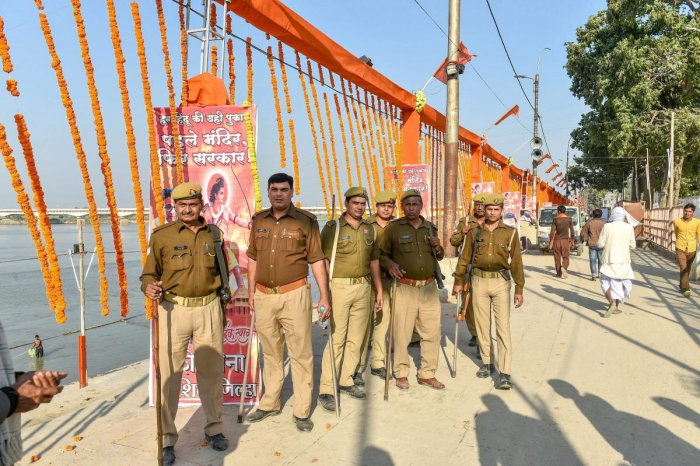 Security personnel stand guard at Lakshman Kila ahead of the Ram Temple event separately organised by Shiv Sena and the Vishva Hindu Parishad (VHP) to be held tomorrow, in Ayodhya, Saturday. (PTI Photo/Nand Kumar)