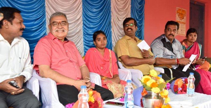 Former Union additional secretary C V Gopinath shares a word with BEO Shivakumar during the centenary celebration of Gadichowka Government School, Lakshmipuram, in Mysuru, on Saturday. SDMC president Seema, BRC K Nagesh, Corporator Soumya Umesh, are seen.
