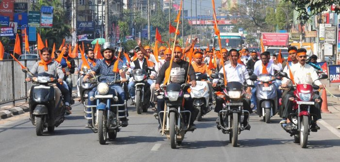 Vishwa Hindu Parishad activists participate in a bike rally amid 'Dharam Sabha', being organised by the Vishwa Hindu Parishad to push for the construction of the Ram temple at Ayodhya, in Guwahati on Sunday. PTI