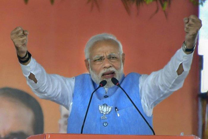 Prime Minister Narendra Modi addresses a public meeting for Madhya Pradesh Assembly elections campaign, in Vidisha, Sunday, Nov. 25, 2018. (PTI Photo)