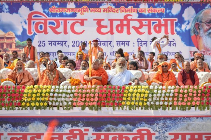 Seers from different ashrams gather at the programme venue as they participate in a rally `Dharam Sabha', being organised by the Vishwa Hindu Parishad to push for the construction of the Ram temple, in Ayodhya, Sunday, Nov. 25, 2018. (PTI Photo)
