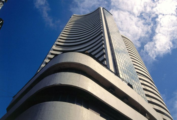 The 30-share Sensex pared early gains and was trading 4.38 points, or 0.01 per cent, higher at 34,985.40.
