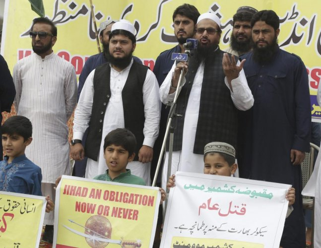 Hafiz Saeed, head of the Pakistani religious party, Jamaat-ud-Dawa addresses a rally to express solidarity with Indian Kashmiris in Lahore, Pakistan, Friday, April 13, 2018. They have rallied to denounce the recent killings by Indian forces in the dispute