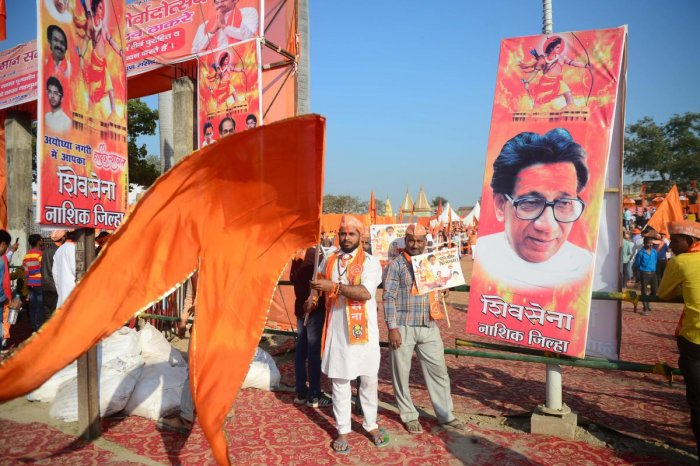 Shiv Sena activists wave a flag at Lakshman Qila during an event for the construction of Ram temple in Ayodhya on November 24, 2018. (AFP File Photo)