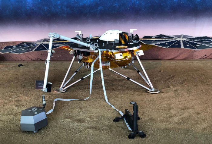 A full-scale replica of NASA's Mars InSight, a robotic stationary lander that marks the first spacecraft designed to study the deep interior of the Red Planet, or any distant world, is seen inside a large tent on the campus of NASA's Jet Propulsion Labora