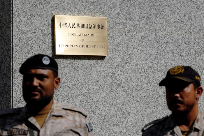Paramilitary soldiers stand guard outside, after an attack on the Chinese consulate, in Karachi, Pakistan. REUTERS