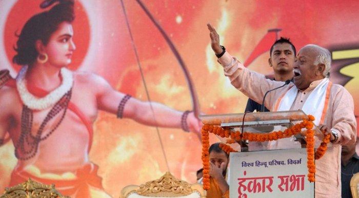 "Nagpur: RSS Chief Mohan Bhagwat addresses during the ""Hunkaar Sabha"" organised by Vishwa Hindu Parishad (VHP) to mobilise support in favour of Ram Mandir at Ayodhya, in Nagpur, Maharashtra, Sunday, Nov 25, 2018. (PTI Photo) (PTI11_25_2018_000251A)"
