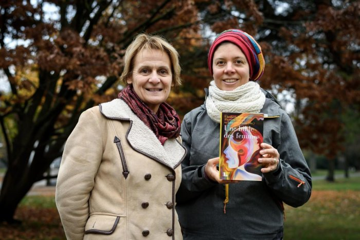"""Geneva theology professors Elisabeth Parmentier and Lauriane Savoy pose with an edition of """"A Women's Bible"""" on November 20, 2018 in Geneva. AFP"""