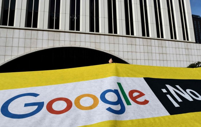 Amnesty International activists gather for a protest outside the Google headquarters in Madrid as part of a campaign calling on Google to cancel its controversial plan to launch a censored search engine in China.AFP