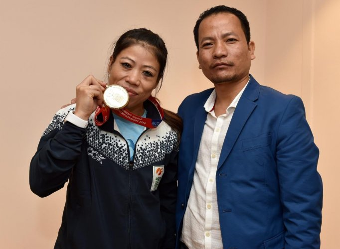 Boxer Mary Kom and her Husband K Onler Kom poses with gold medal after winning the final match of women's light flyweight 45-48 kg against Ukraine's Hanna Okhota at AIBA Women's World Boxing Championships, in New Delhi. PTI Photo