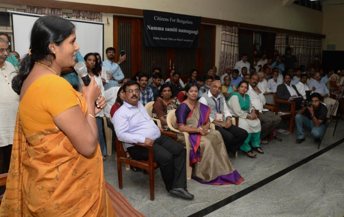Mayor Gangambike Mallikarjun speaks at the public roundtable meet organised to discuss about the upcoming ward committee meetings on Tuesday. BBMP commissioner N Manjunath Prasad, BBMP ruling party leader M Shivaraju and others are seen. DH photo/Satish B