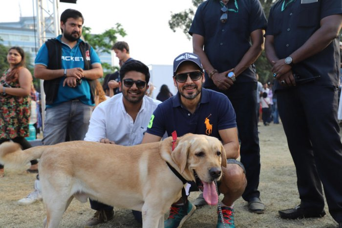 Akshay Gupta, founder of PetFed and actor Dino Morea pose for a picture with a dog at Mumbai Pet Fed 2017.