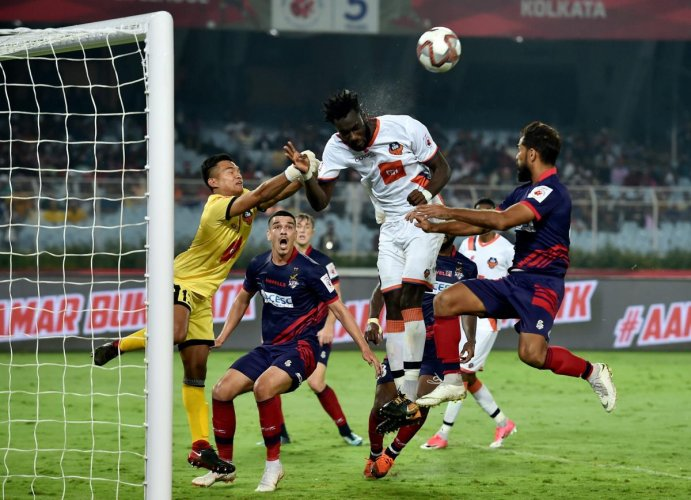 FC Goa and ATK players vie for the ball during their ISL match in Kolkata on Wednesday. PTI