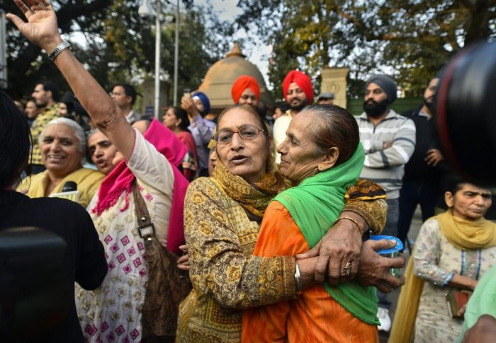 Family members of the victims of 1984 anti-Sikh riots celebrate outside the Patiala House Court in New Delhi, Tuesday, Nov 20, 2018, after the pronouncement of the first death punishment in the case. (PTI Photo/Kamal Singh)