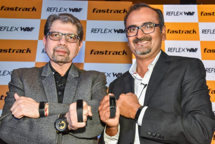 Titan CEO- Watches and Accessories S Ravi Kant (L) and Titan Business Head- Wearables Somprabh Kumar Singh pose with the Reflex WAV watch in Bengaluru on Thursday. DH Photo