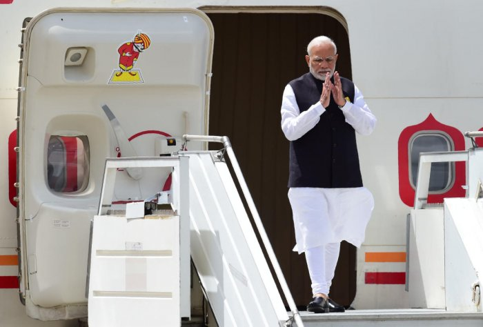 India's Prime Minister Narendra Modi steps off his plane upon arrival at Ezeiza International airport in Buenos Aires province, on November 29, 2018. - Global leaders gather in the Argentine capital for a two-day G20 summit beginning on Friday likely to b