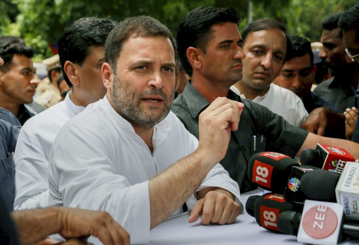 Congress President Rahul Gandhi addresses the media personnel outside a court at Bhiwandi, in Thane on Tuesday. PTI