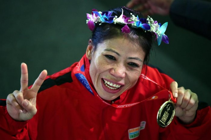 India's Mary Kom celebrates with the gold medal. PTI