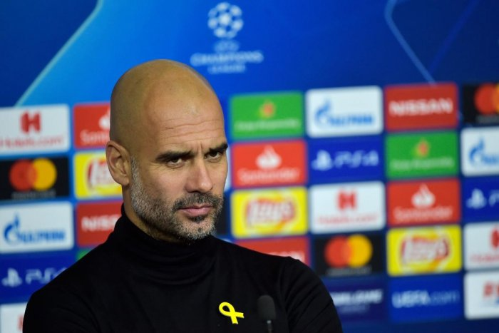 Pep Guardiola says FIFA proposals designed to limit the number of players allowed to be loaned out to rival clubs will seriously alter Manchester City's business model. AFP Photo