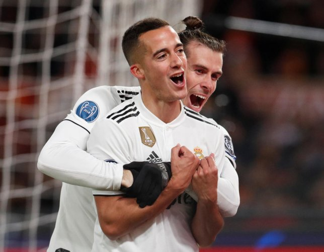 TWIN TROUBLE Real Madrid's Lucas Vazquez (front) celebrates with Gareth Bale after scoring their second goal against Roma on Tuesday. REUTERS