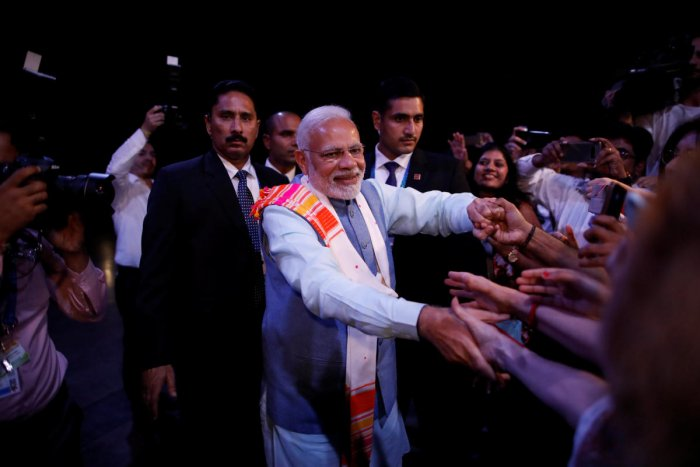"""Prime Minister Narendra Modi greets attendees at the end of a sideline event ahead of the Group 20 summit called """"Yoga por la paz"""" (Peace through Yoga) in Buenos Aires, Argentina. Reuters Photo"""