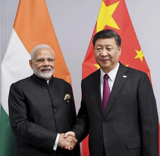Prime Minister Narendra Modi shakes hands with Chinese President Xi Jinping on the sidelines of G-20 summit, in Buenos Aires. PTI Photo