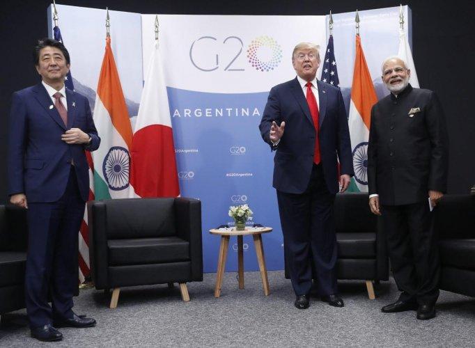President Donald Trump meets with Japan Prime Minister Shinzo Abe, left, and India's Prime Minister Narendra Modi. PTI Photo