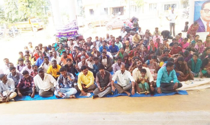 District Dalit Sangharsha Samithi members stage a protest in front of the Mini Vidhana Soudha in Virajpet on Saturday.