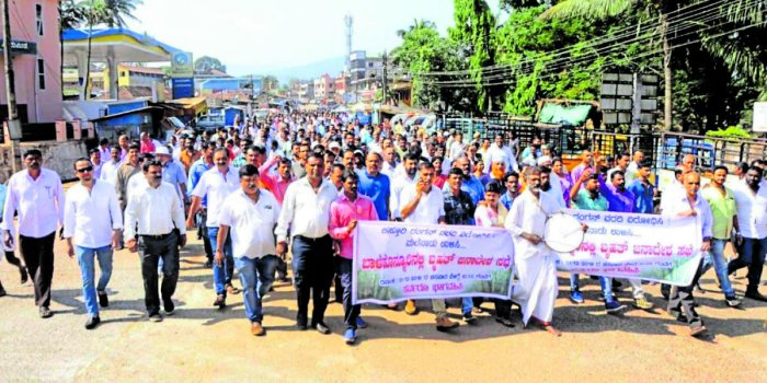 A large number of people take part in a protest against the implementation of Kasturirangan report recommendations, in Balehonnur, on Saturday.