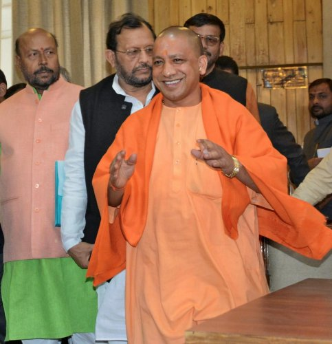 Uttar Pradesh Chief Minister Yogi Adityanath with state Urban Development Minister Suresh Khanna. PTI file photo