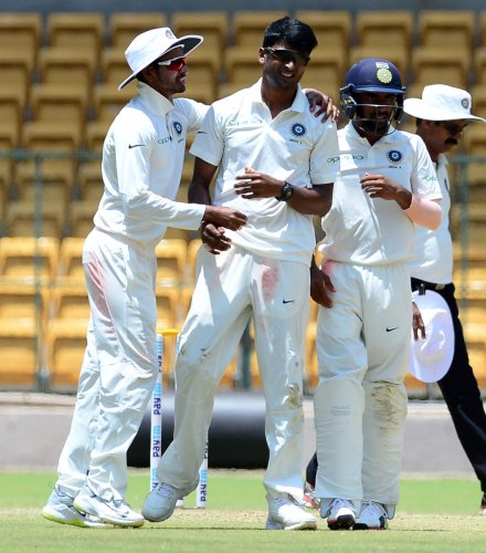 K Gowtham (centre) bagged 6/139 as India 'A' dismissed New Zealand 'A' for 398 in their first innings. DH File Photo