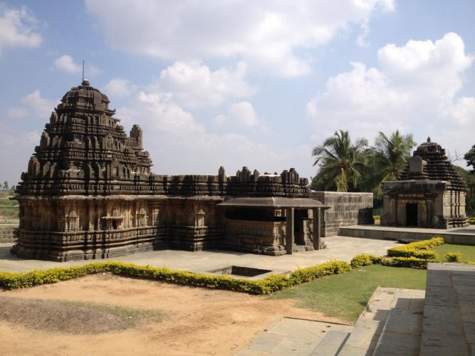 Finely proportioned: Mukteshwara Temple at Chaudadanapura in Haveri district; (right) a sculpture on the temple's wall. Photos by author